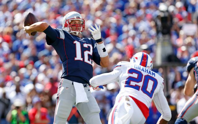 Sep 20, 2015; Orchard Park, NY, USA; New England Patriots quarterback Tom Brady (12) throws a pass as Buffalo Bills free safety Corey Graham (20) rushes during the first quarter at Ralph Wilson Stadium. Mandatory Credit: Kevin Hoffman-USA TODAY Sports