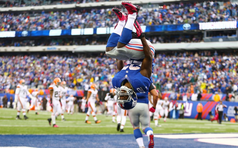 EAST RUTHERFORD, NJ - OCTOBER 07:  David Wilson #22 of the New York Giants celebrates his touchdown against the Cleveland Browns by doing a backflip during their game at MetLife Stadium on October 7, 2012 in East Rutherford, New Jersey.  (Photo by Al Bello/Getty Images)
